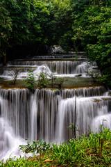 Fototapeta Wodospad Huai Mae Kamin Waterfall in the rainy season at the tropical forest of Kanchanaburi National Park, Thailand