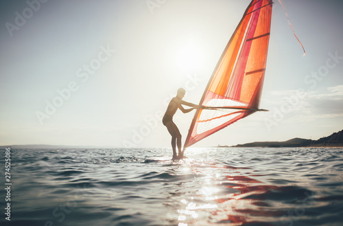 Fotografie, Obraz  Surfer sailing on the windsurf board, copy space