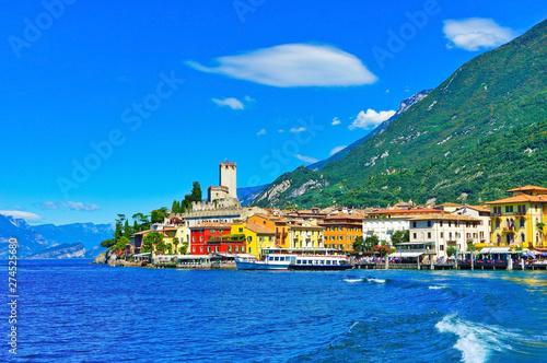 Fotografie, Obraz Malcesine at the lakeside of Lake Garda in summer