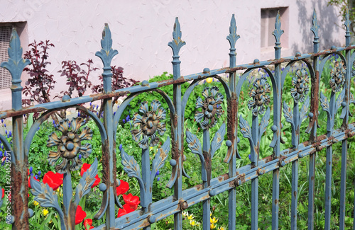 Canvas Print old rusty wrought iron fence painted blue