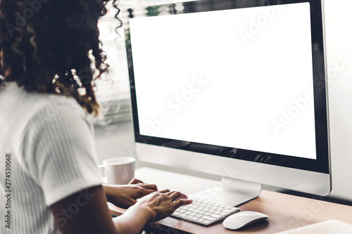 Fotografía African american black woman using computer with white mockup blank screens in m