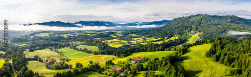 Foto auf Leinwand Weiß Aerial Bad Toelz Bavarian Alps. Golf Course. Blomberg Mountain. Morning Drone Shot with some clouds in the sky