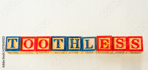The term toothless visually displayed on a clear background using colorful woode Wallpaper Mural