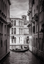 Venice In Black And White, Italy. Old Narrow Street With Lone Gondola In Distance.