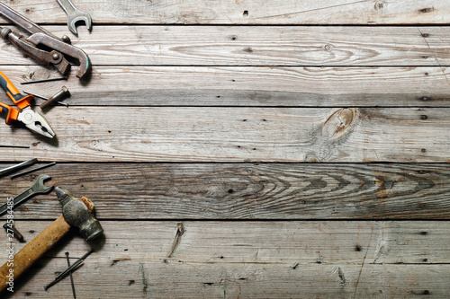 Photo Flat lay composition with vintage carpentry tools on rough wooden background