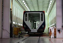 Inside Of The Rail Car Assembly Plant. Industrial Workshop For The Production Of European High Speed Trains. Painting A Train At The Stadler Minsk Rolling Stock Plant