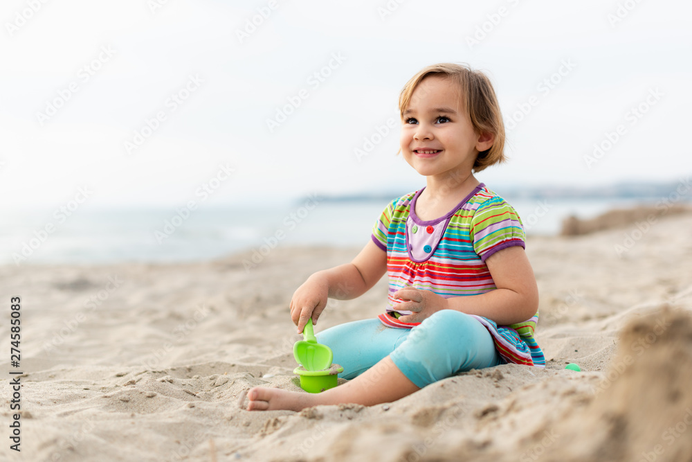 Fototapety, obrazy: Happy Child Girl Playing with Sand at Beach in a Summer Evening