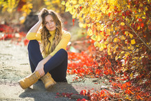 Young Attractive Blond Woman Outdoors On Fall Background. Autumn Portrait Of Beautiful Stylish Woman.