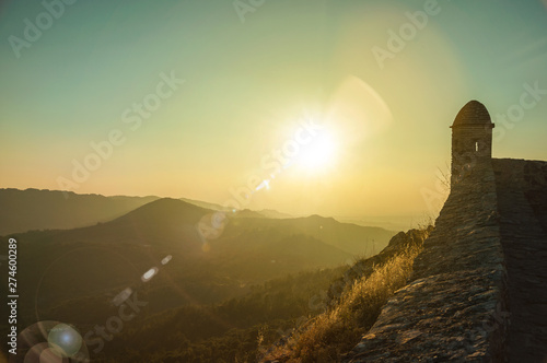 Watchtower and stone wall over rocky cliff in Marvao Fototapeta