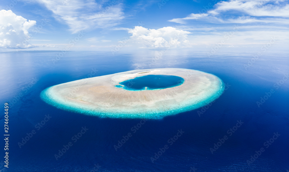 Fototapeta Aerial idyllic atoll, scenic travel destination Maldives Polinesia. Blue lagoon and turquoise coral reef. Shot in Wakatobi National Park, Indonesia
