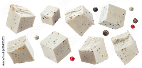 Obraz na plátně  Greek feta cubes with herbs and spices, diced soft cheese isolated on white back
