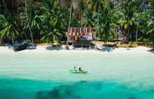 Couple Enjoying Time Kayaking In Front Of The Beach In Coron. Concept About Summer, Lifestyle,wanderlust Travel And Nature