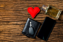 Concept Of Fathers Day Or Valentines Day With Wallet, Perfume Key And Cell Phone.