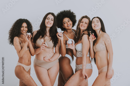 Fotografie, Obraz  Group of women with different body and ethnicity posing together to show the woman power and strength