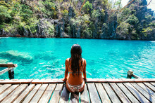 Beautiful Girl Relaxing At The Kayangan Lake. Concept About Vacations And Tropical Places