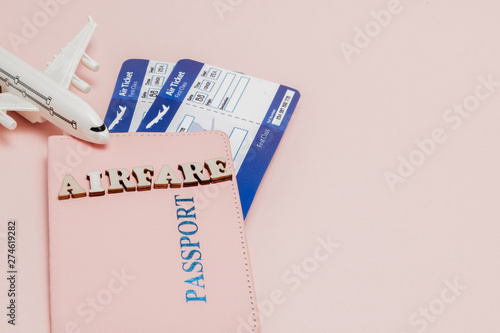 Inscription airfare, Airplane, air ticket and money on a pink background Canvas Print