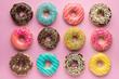Leinwandbild Motiv Colorful sweet background. Delicious glazed donuts on pink background.