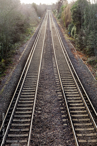 Photo  Railway lines pair recede into distance