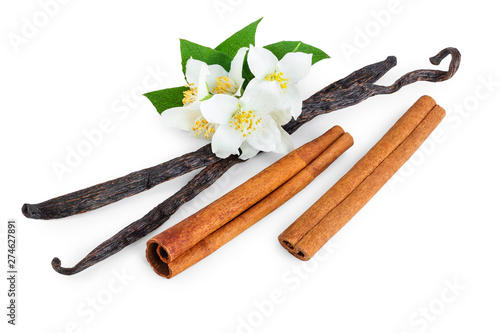 Fototapeta Vanilla and cinnamon sticks with flower and leaf isolated on white background obraz