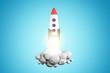 Launching rocket on blue background