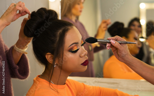 Obraz Open workshop hairdressing. Master class makeup art shows on model. Fashion professional. Practice skills obtained at vocational training centre. vlogger  makeup tutorial channel. Concept of study. Ba - fototapety do salonu