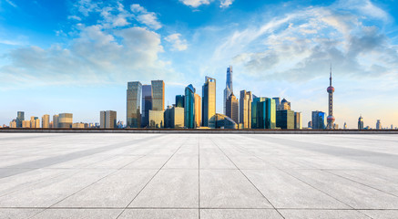 Shanghai skyline and modern city skyscrapers with empty floor at sunset,China