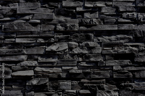Dark anthracite gray, almost black texture of a wall made of horizontal slim cut stone blocks Canvas Print