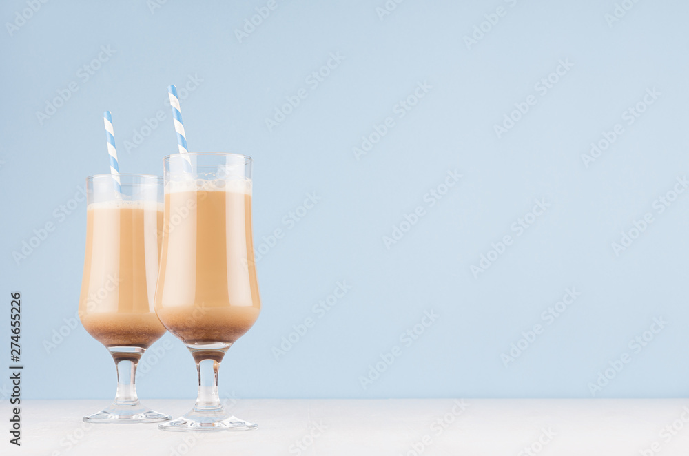 Fototapety, obrazy: Refreshment coffee drinks with cream, foam and striped straw in wineglass in light blue interior on white wooden table, copy space.