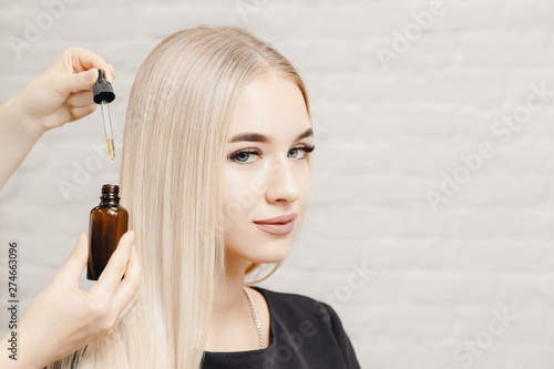 Master hairdresser procedure oil hair treatment for woman Canvas Print