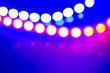canvas print picture - Purple blue neon garlands of bokeh lights and reflections. Festive Abstract background of 80s colors