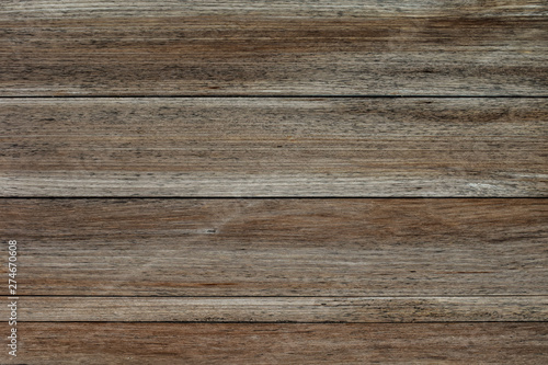 Türaufkleber Holz Close-up of wall made of wooden planks. Old dark brown wooden wall background texture.