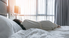 Sleeping In Hotel Bed With Good Rest Of Young Woman Lifestyle Lying In Bedroom Relaxing Waking Up Late In The Morning For World Lazy Day Concept