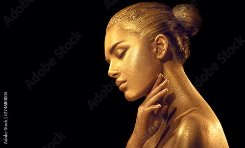 Beauty sexy woman with golden skin. Fashion art portrait closeup. Model girl with shiny golden professional makeup. Gold jewellery