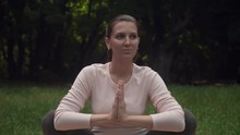 A Pregnant Woman Practicing Yoga In The Park On A Rug, Doing The Asana Malasana, A Pose Of A Crow Or A Pose Of A Frog. Relaxation And Being In Asana.