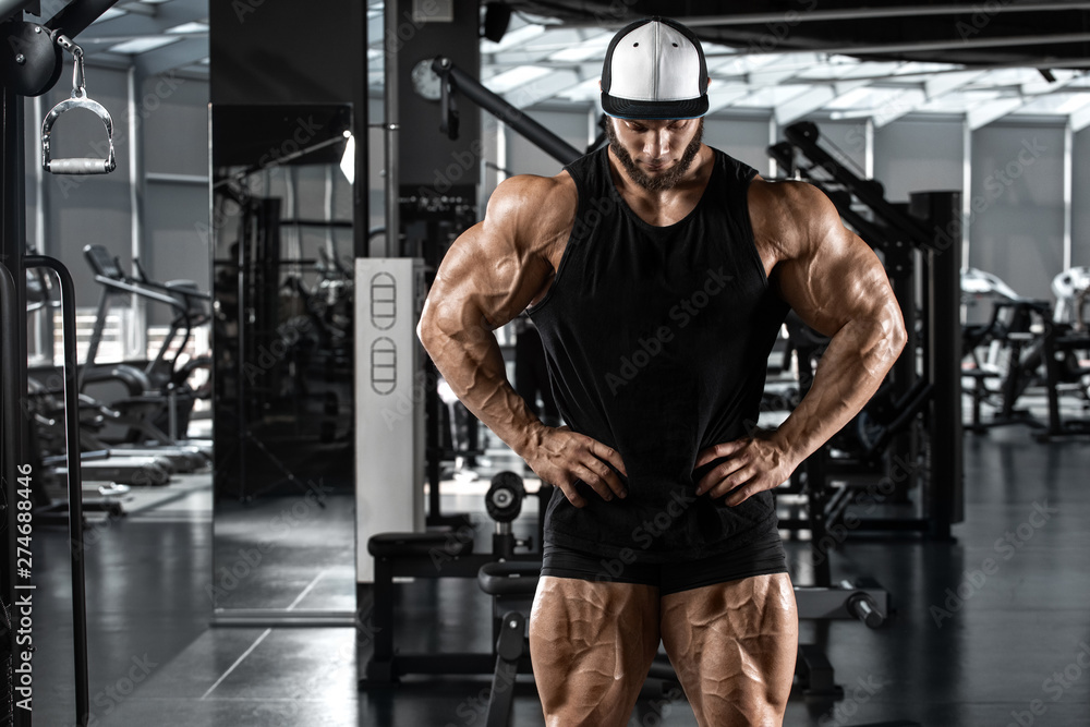 Fototapety, obrazy: Muscular man showing muscles in gym, workout. Strong bodybuilding male
