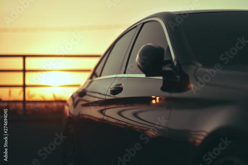 luxury business car closeup on sunset Canvas Print