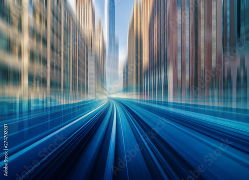Foto auf AluDibond Blaue Nacht Futuristic scene Motion blur movement between elevated train line over the railroad tracks with building at the Loop line at Chicago, Illinois, USA, innovation and technology concept
