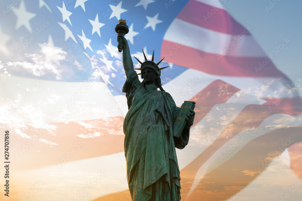 Fototapety, obrazy: Double exposure with statue of liberty and United States flag blowing in the wind.