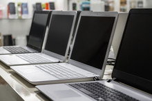 A Row Of Laptops In Computer S...