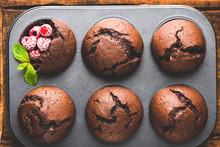 Tasty Chocolate Muffins In Bak...