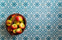 Basket Of Apple On Kitchen Tile Floor