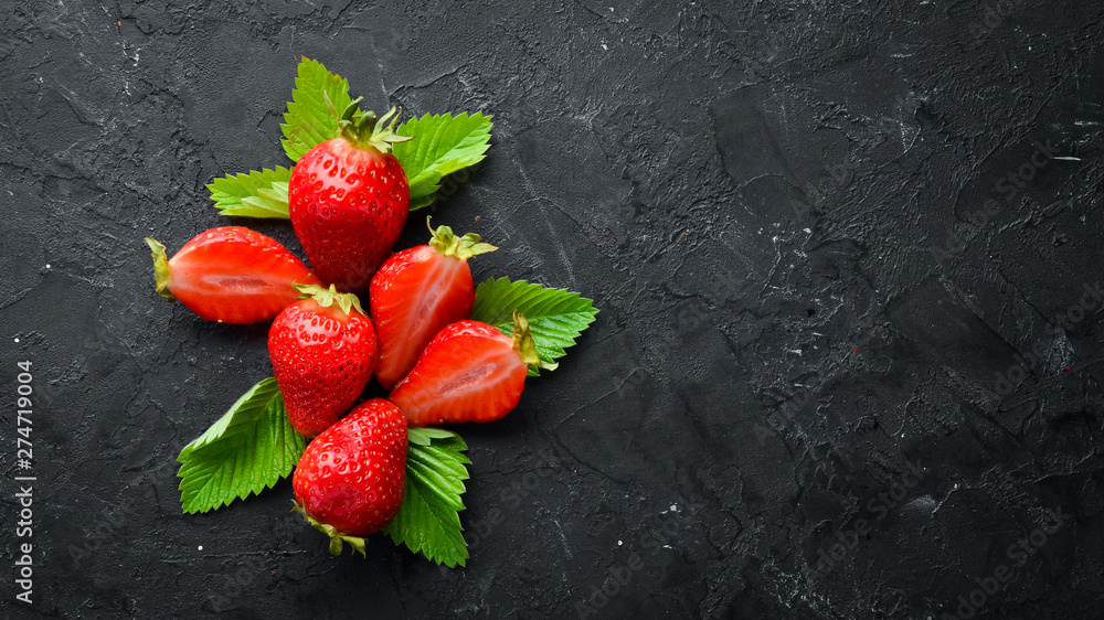 Fototapety, obrazy: Fresh strawberry with leaves on a black stone background. Berries Top view. Free space for your text.