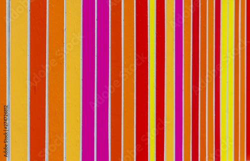 Fence rails, painted in different colors. Beautiful colorful background.