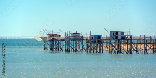 Typical old wooden fishing huts on stilts in the atlantic ocean near La Rochelle Tapéta, Fotótapéta