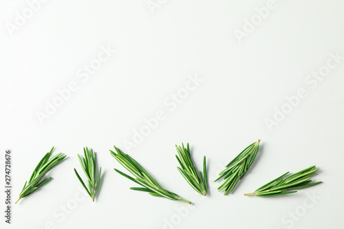 Flat lay composition with rosemary on white background, space for text Obraz na płótnie
