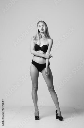 Fototapeta portrait of exquisite woman in lingerie sitting. obraz na płótnie