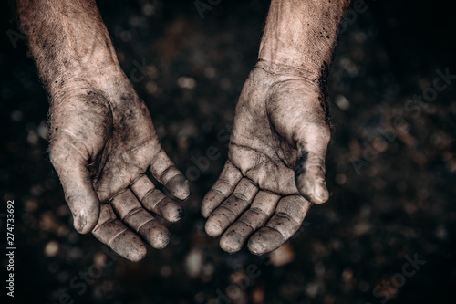 Dirty hands of worker miner are corns palms in abrasions. Concept hard work - 274733692