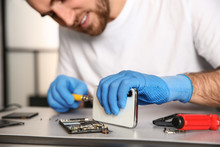 Technician Repairing Mobile Ph...