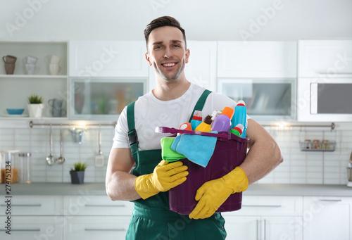 Fotografie, Obraz  Portrait of janitor with bucket of detergents in kitchen