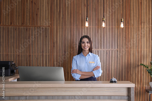 Fototapeta Portrait of receptionist at desk in lobby